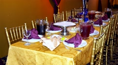 Luxury banquet table setting at restaurant. Blurred background with bokeh. Set Stock Footage