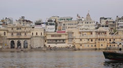 Boat with tourists on lake Pichola,Udaipur,India Stock Footage