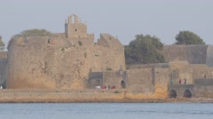 Tourists walking at Fort,Diu,India Stock Footage