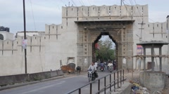 Traffic through gate,Udaipur,India Stock Footage