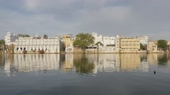 Hotels at lake lake Pichola with reflection,Udaipur,India Stock Footage