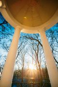 Sun at sunset shining through gazebo in city park in Gomel, Belarus Stock Photos
