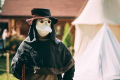 Plague doctor - participant of festival of medieval culture Stock Photos