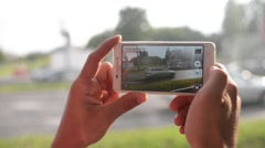 Tourist with Mobile Sell Phone in Hands recording video view of the streets city Stock Footage