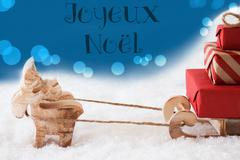 Reindeer With Sled, Blue Background, Joyeux Noel Means Merry Christmas Stock Photos