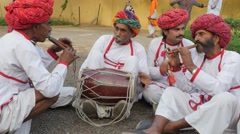 Traditional indian musicians with turban,Jaipur,Gangaur,India Stock Footage