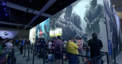 Pan across Sony PlayStation booth at E3 2016 gaming conference Stock Footage