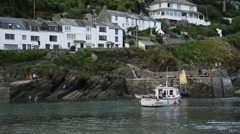 Fishing boat in an English fishing village in Cornwall Stock Footage