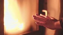 Man Warming Hands in front of Burning Fireplace, 4K Close Up. Stock Footage