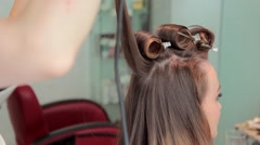 Closeup hairdresser coiffeur makes hairstyle. Stock Footage