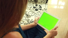 Woman with green chromakey tablet Stock Footage
