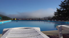 View on the Swimming Pool From the Chaise Longue Stock Footage