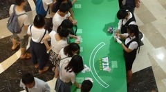 Poker quiz game, in celebration of the mall. In Shenzhen, China Stock Footage