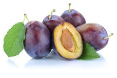 Plums plum prunes prune slice leaves fruits fruit isolated on white Stock Photos