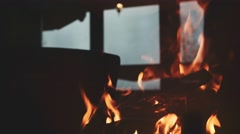 Burning Fire and Window Reflection in a Fireplace Protection Glass. 4K. Stock Footage