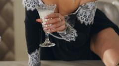 Close up lady glaringly drinks milk Stock Footage