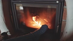 Woman Feet in Woollen Socks by the Fireplace, 4K. Close Up Stock Footage