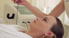 Beautiful woman with a beautician on the procedures Stock Footage