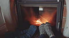 Couple Feet in Woollen Socks by the Cozy Fireplace, 4K. Close up. Stock Footage