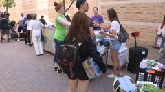 Diverse college and university students move in to residence dorms Stock Footage