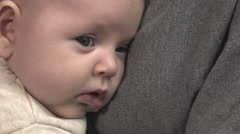 Tender mother holds her baby in the chest: baby is falling asleep after feeding Stock Footage