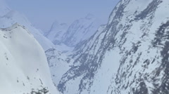 Snow Covered Mountains Fly-Through Stock Footage