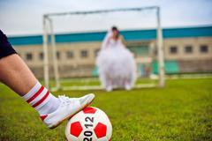 European Football Championship concept. Bride and groom on the football stadi Stock Photos