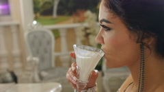 Close up lady glaringly drinks milk in slow motion Stock Footage
