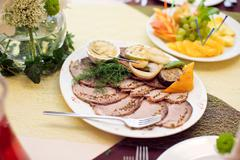 Sliced turkey with aromatic herbs Stock Photos