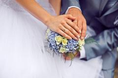 Hands of the groom and the bride with wedding rings Stock Photos