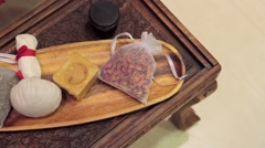 Accessories for Thai massage on a wooden table Stock Footage