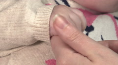 Parent holding newborns hand. Hand in hand. Mother and her Newborn Baby Stock Footage