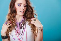 Pretty woman with jewelry necklaces ring bracelets Stock Photos