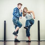 Couple of young man and woman dancing hip-hop Kuvituskuvat
