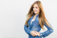 Coquette girl is wearing denim shirt. Stock Photos
