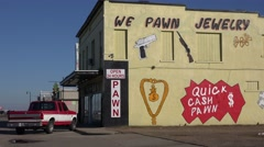 "Establishing shot of a pawn shop with a sign saying we pawn jewelry""."" Stock Footage"