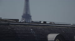 The Eiffel Tower in Paris France as seen from city rooftops Stock Footage