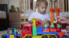 The children plays with the toys in the playroom Stock Footage