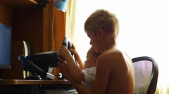 Children playing a computer game Stock Footage