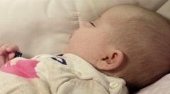 Newborn female baby closeup portrait at home  Stock Footage