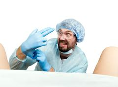 Crazy gynecologist examines a patient. mad doctor expression different emotions Stock Photos