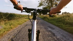 Riding on a MRB bike in summer evening countryside on dirty road Stock Footage
