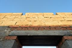 House interior brick walls under construction and showing new building work a Stock Photos