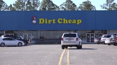 Cars in the parking lot of a Dirt Cheap discount store. Stock Footage