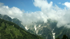 Dynamic clouds looming over mountains Stock Footage
