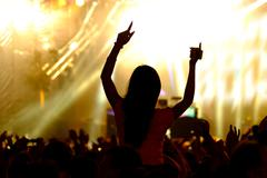 Fans cheering at open-air live concert. Stock Photos