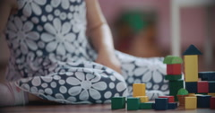 Cute little Girl Playing with Toy Blocks in her Room Stock Footage