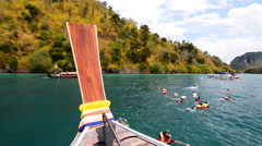 Traditional long tail boat travel - tour lagoon in Krabi, Thailand. Stock Footage