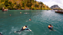 Tourists diving and swimming in andaman sea Stock Footage
