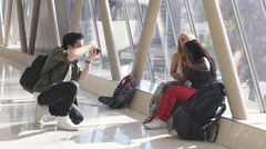 Travelling friends taking photos of eachother Stock Footage